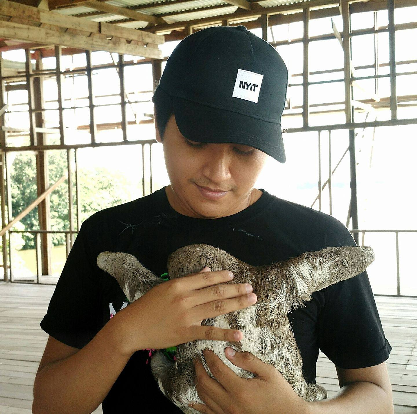 Patrick with baby sloth